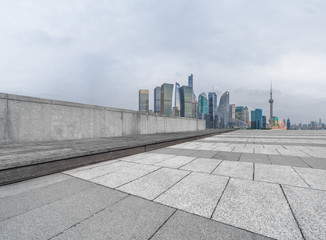 cityscape and skyline of shanghai from empty brick floor.