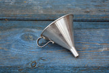 Vintage metal funnel with handle on old wooden  garden table