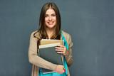 Smiling student or teacher holding books. - 171567068