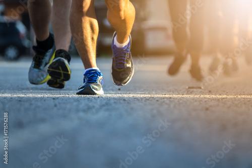 Fototapeta Legs of people on marathon running. Run for health.