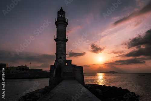 Fotobehang Vuurtoren Sunset over the lighthouse and old Venetian harbour in Chania, Crete