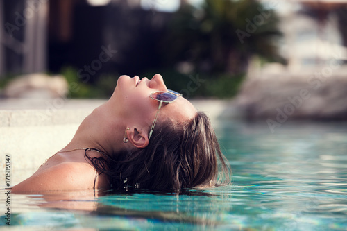 sexy woman relaxing at the luxury poolside. Poster