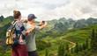 Couple tourist makes photo karst mountains.