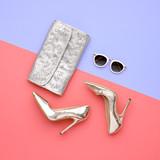 Fototapety Minimal. Bright Art Creative Style. Glamor fashion shoes Heels. Trendy Sunglasses fashionable Woman Handbag Clutch. Luxury Shiny Party lady.