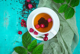 Freshly brewed tea with summer ripe berries. Top view with copy space - 171600275