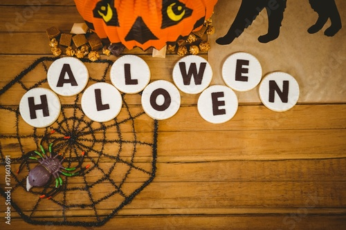Cookies with halloween text and decorations on table