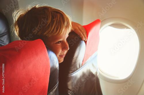 kids travel- cute little boy in plane