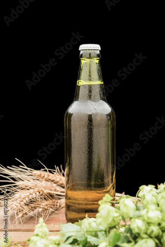 Fotobehang Koffiebonen bottle of beer with hop and wheat and a glass