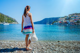 Girl on Assos on the Island of Kefalonia in Greece. - 171626623