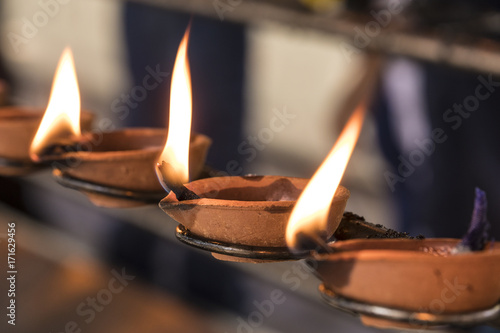 Buddhistic ritual: Burning lamp, so that a wish goes into fulfillment