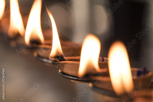 Foto op Canvas Zen Buddhistic ritual: Burning lamp, so that a wish goes into fulfillment
