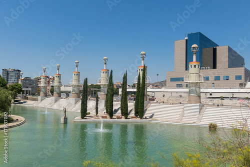 Panorama of Parc de l'Espanya Industrial in summer day. In the background, Sants station, the main train station of the city