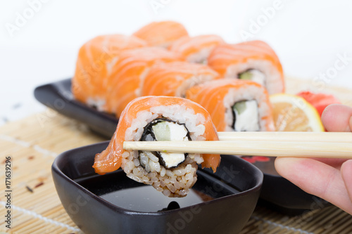 Fotobehang Sushi bar Salmon sushi rolls
