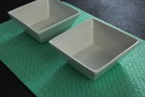 Two white bowls on place mat - 171648467