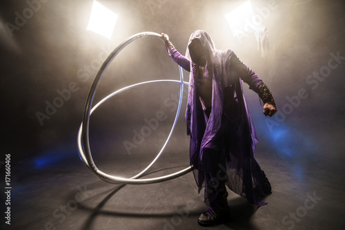 Fairy-tale character assassin in a purple cloak with a hood with two large cross Poster