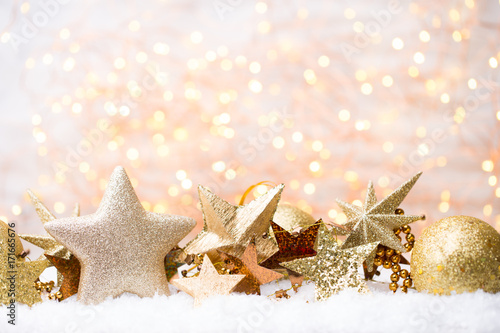 Christmas greeting card with christmas gold decorations.