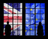 Silhouette of a couple standing and looking through big window at cracked and damaged United Kingdom and European union flags. - 171725212