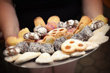 Hands holding plate with cookies and biscuits - 171737091