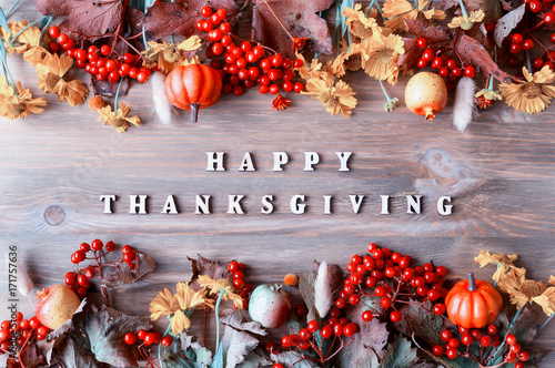 Thanksgiving day autumn background with with Happy Thanksgiving letters, seasonal autumn berries, pumpkins, apples - 171757636