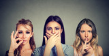 Keep a secret be quiet concept. Three secretive young women keeping mouth shut. - 171773060