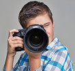 Boy with camera taking pictures.