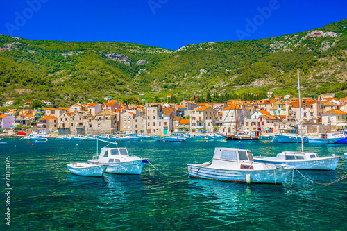 Fotobehang Groen blauw Komiza Vis summer landscape. / Seafront view at colorful adriatic scenery in town Komiza, famous croatian summer resort on Island Vis.