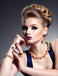 Pretty girl with beautiful hairstyle  and gold jewelry, bright make-up