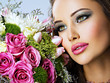 beautiful woman with  bouquet of fresh spting flowers at face.