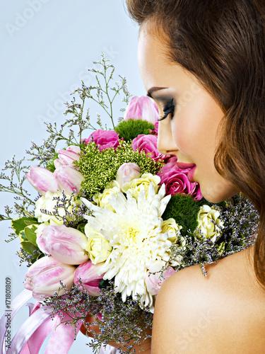 Portrait of beautiful girl with flowers in hands Slika na platnu