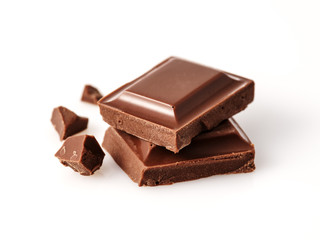 Macro photo of Chocolate bar. Broken pieces over white background.