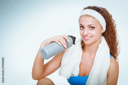 Young woman doing exercises . isolated on white background