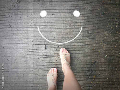 Smile face on road and woman feet background Poster