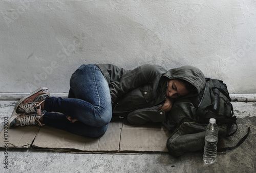 Homeless woman sleeping on the street