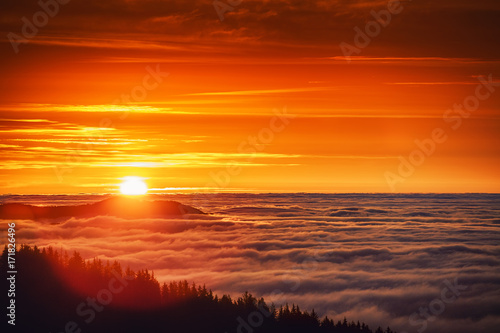 Fotobehang Bruin Aerial view of Sunrise over mountain and fog