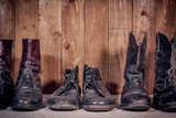 Old leather boots on dirt wooden background   - 171852417