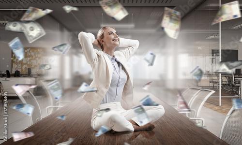 Obraz na płótnie Business lady meditating at work. Mixed media