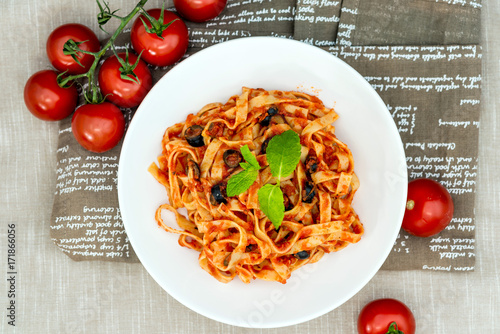 Spaghetti with tomato sauce on a the table - 171866056