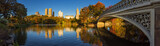 Fall in Central Park at The Lake with the Bow Bridge. Panoramic morning view with colorful autumn foliage on the Upper West Side. Manhattan, New York City - 171866669