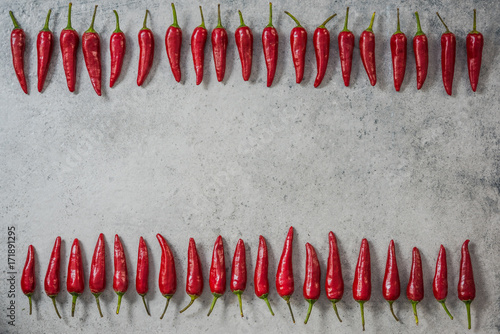 Red chili peppers in row, food background