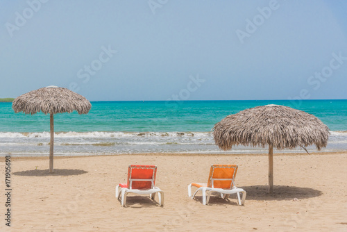 Beach umbrellas on Caribbean sea Poster