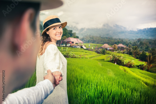 Happy couple traveling in jatiluwih rice terrace, Bali, Indonesia.