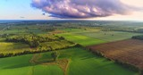 Scenic Rural Landscape with amazing early morning lighting and heavy clouds, aerial view. - 171913092