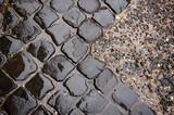 Wet cobblestone road - 171921078