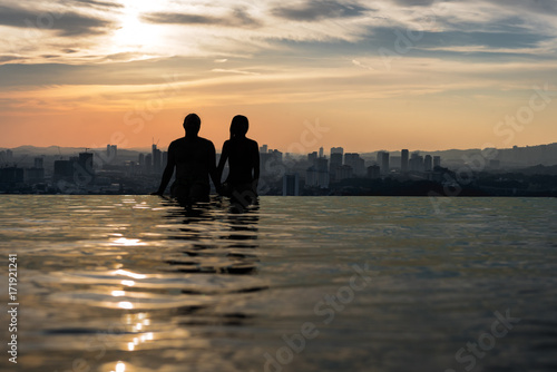 Sitting on the edge of an infinity pool looking at the panoramic view Poster