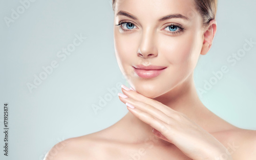 Leinwanddruck Bild Beautiful Young Woman with Clean Fresh Skin . Facial  treatment   . Cosmetology , beauty  and spa .  Skin care