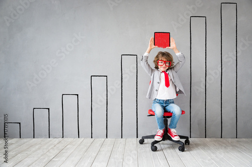 Wall mural Child pretend to be businessman