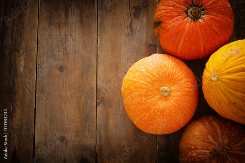 Pumpkins on wooden background. thanksgiving and halloween concept
