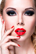 Portrait of beautiful  woman with  red lips and nails.