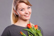 Happy blonde woman with spring flower. - 171935842