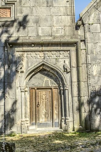 Papiers peints Beige North-western view of the entrance with a carved wooden door in the three tiered bell tower of the Sanahin Monastery